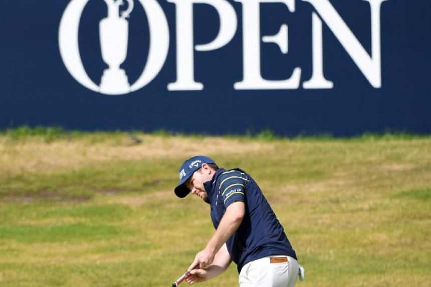 Branden Grace of South Africa on the 18th green during the third round of the British Open at Royal Birkdale.