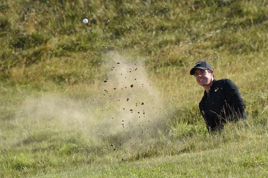 Northern Ireland's Rory McIlroy plays from a bunker on the 10th hole during his third round on day three of the Open Golf Championship at Royal Birkdale golf course near Southport in north west England on July 22, 2017.