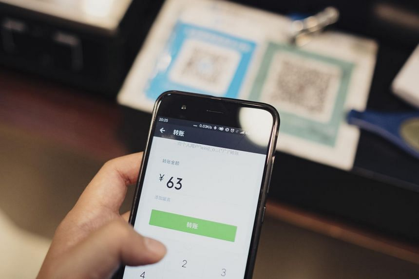 A customer scans a QR code with the WeChat app to pay for dinner in Shanghai, on July 11, 2017.