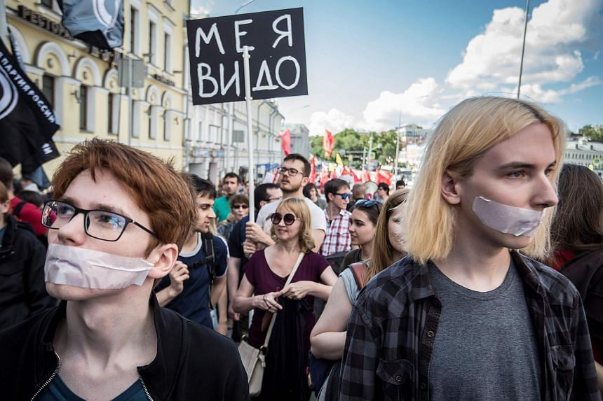 People take part in the March for Free Internet in central Moscow on July 23, 2017.
