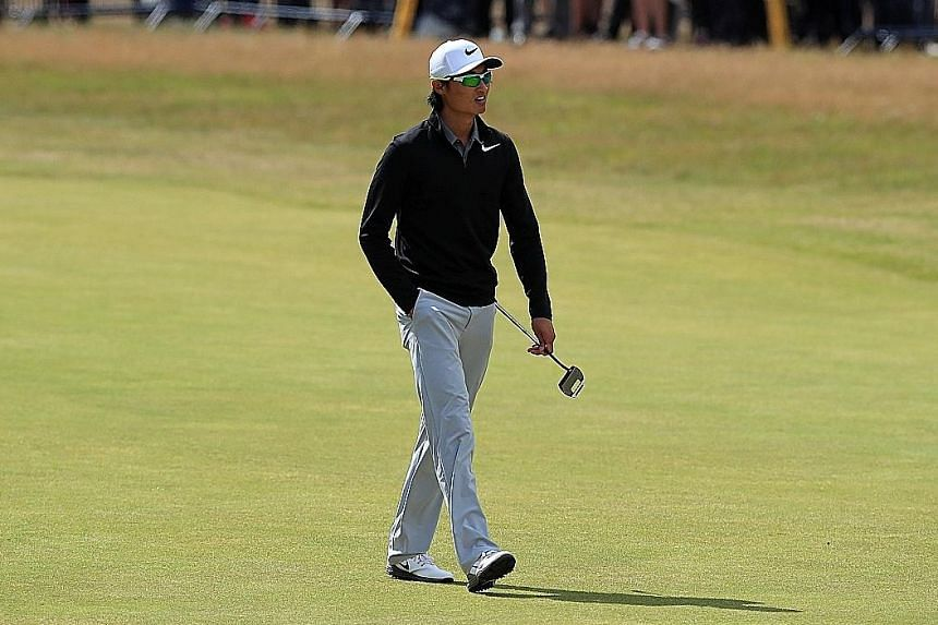 China's Li Haotong walking down the 18th fairway during the final round at Royal Birkdale. He recorded his seventh birdie of the day at the final, par-four hole.
