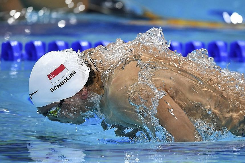 Olympic champion Joseph Schooling broke the national 50m butterfly mark twice yesterday, clocking 23.05sec in the heats (above) and then 22.93sec in the semi-finals.