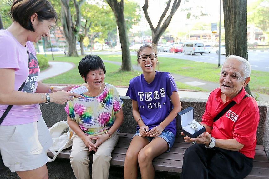Mr Abdullah Basiron, who is known as Uncle Dollah to staff and students at Tanjong Katong Girls' School, with (from left) Madam Khalijah Masud, Mrs Judy Kong and Elya Azuan Ghazali. Apart from the cash and vouchers that were given by the TKGS alumni,