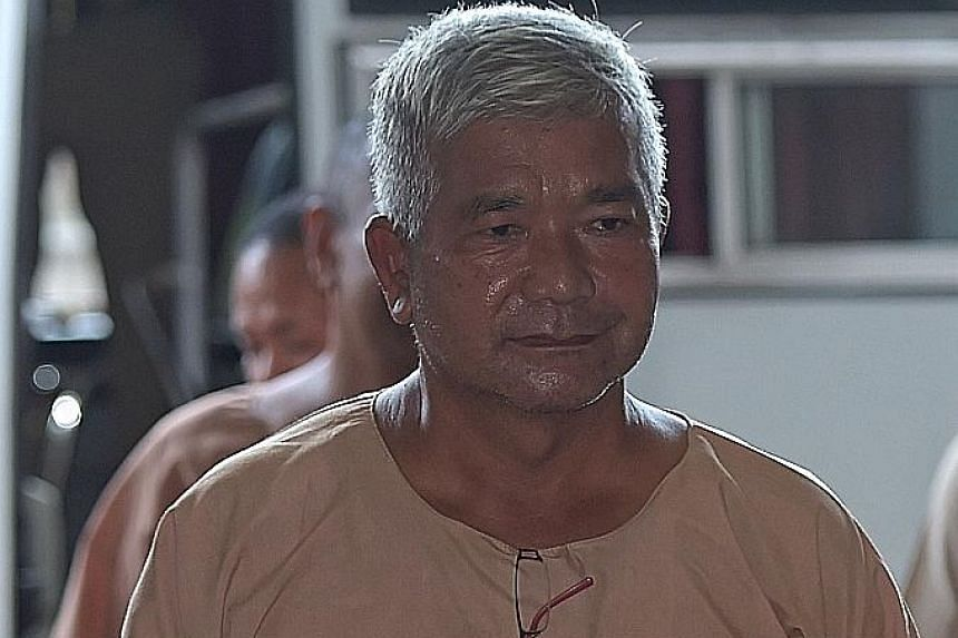 """Army """"Big Shot"""" Manas Kongpan arriving in court in Bangkok in November 2015. Manas, who sat at the apex of Thailand's grisly trade in humans, was sentenced to 27 years in prison on Wednesday."""