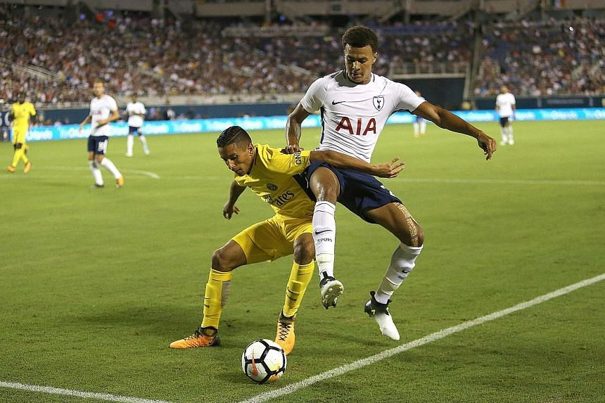 PSG defender Marquinhos fending off Tottenham midfielder Dele Alli during their ICC friendly. Spurs have yet to sign a player.