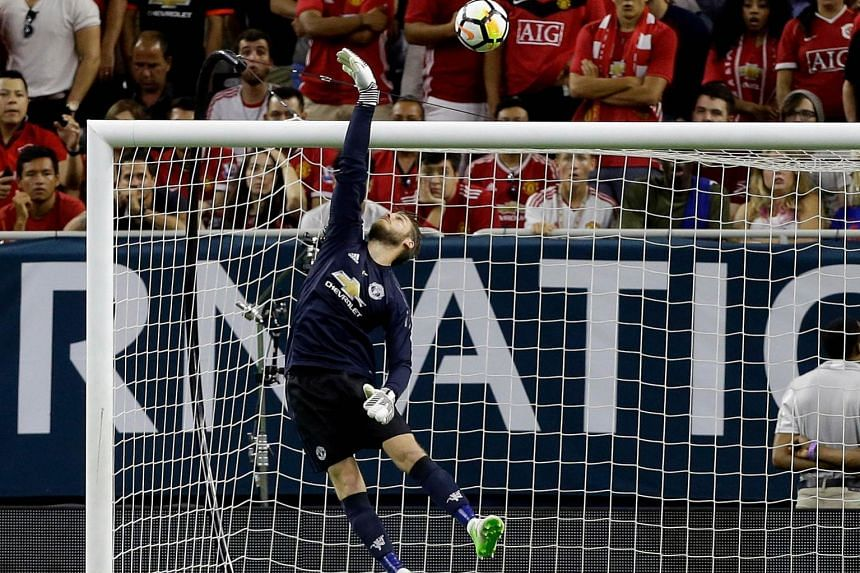 Manchester United goalkeeper David de Gea making a save against City during their International Champions Cup pre-season friendly in the US. He has been a stalwart between the sticks for the team.