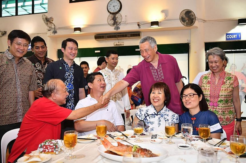Prime Minister Lee Hsien Loong greeting Pioneer Generation Ambassador Koh Ting Beow, 67, at the lunch yesterday. With PM Lee were his wife, Mrs Lee, as well as (from left) fellow Ang Mo Kio GRC MPs Gan Thiam Poh and Darryl David, Sengkang West MP Lam