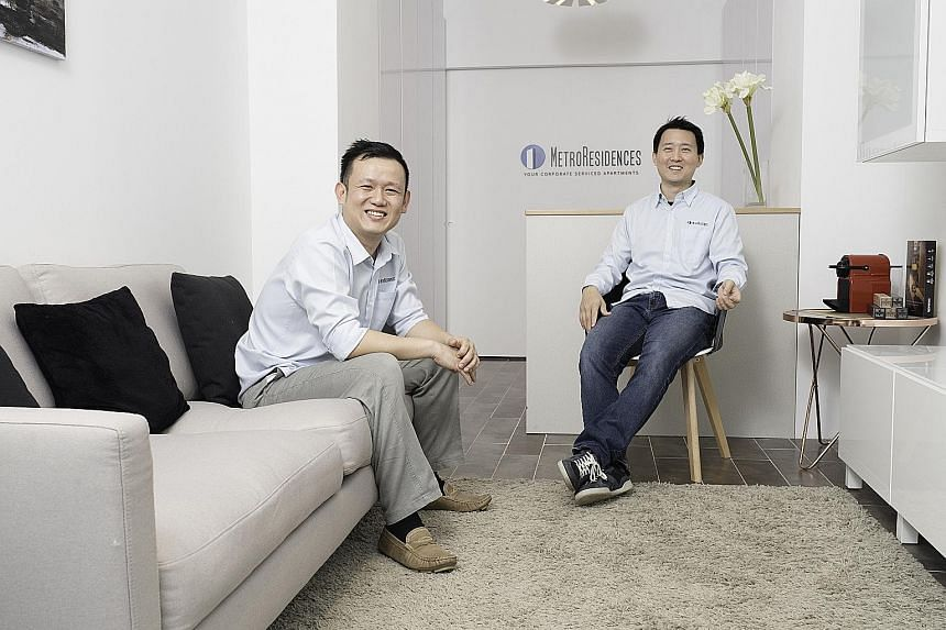 Co-founders Lester Kang (far left) and James Chua of MetroResidences, which is holding a soft launch in Tokyo today. The Singapore start-up now has about 50 listings, including this two-bedroom serviced apartment (above) in the city's Shibuya ward. M