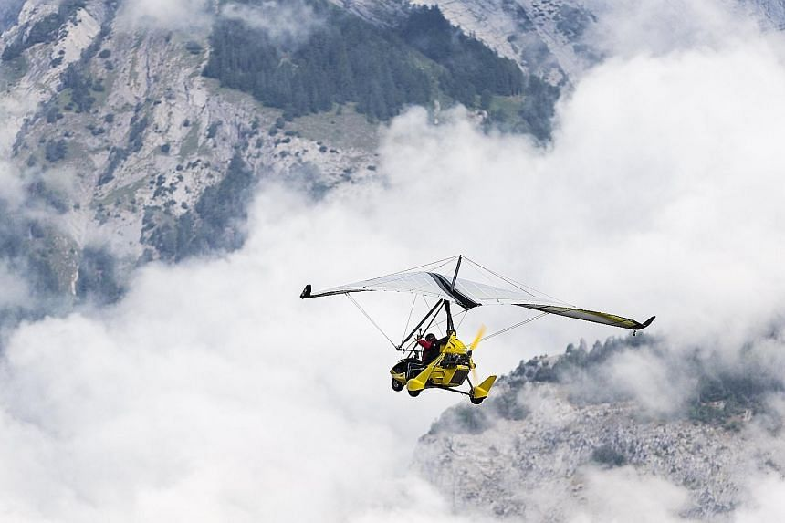 Swiss adventurer Xavier Rosset in his light sport aircraft on the first day of his Fly the World project, which began yesterday in Sion, Switzerland. This attempt to circumnavigate the world in 400 days will take him across five continents and 50 cou