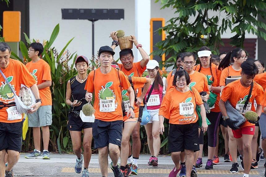 From egg cartons to styrofoam boxes, baskets and plain old gloves, Ang Mo Kio-Hougang residents yesterday came up with creative ways to hold a durian while they ran. About 500 people participated in the 5km durian run yesterday. They paid $15 to take
