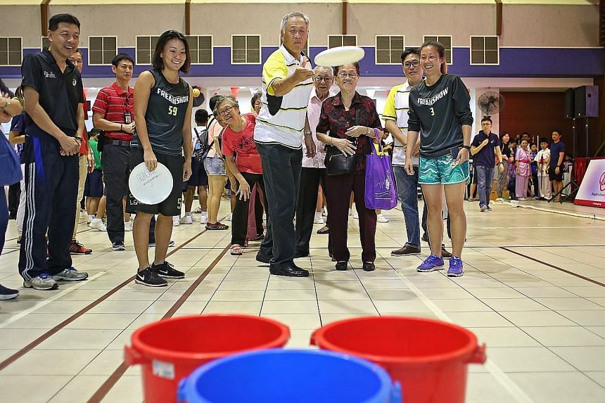 """""""Sports is quite an antidote to the different forces that are pulling communities apart,"""" said Defence Minister Ng Eng Hen (centre), seen at a community sports day organised by the People's Association in Toa Payoh."""