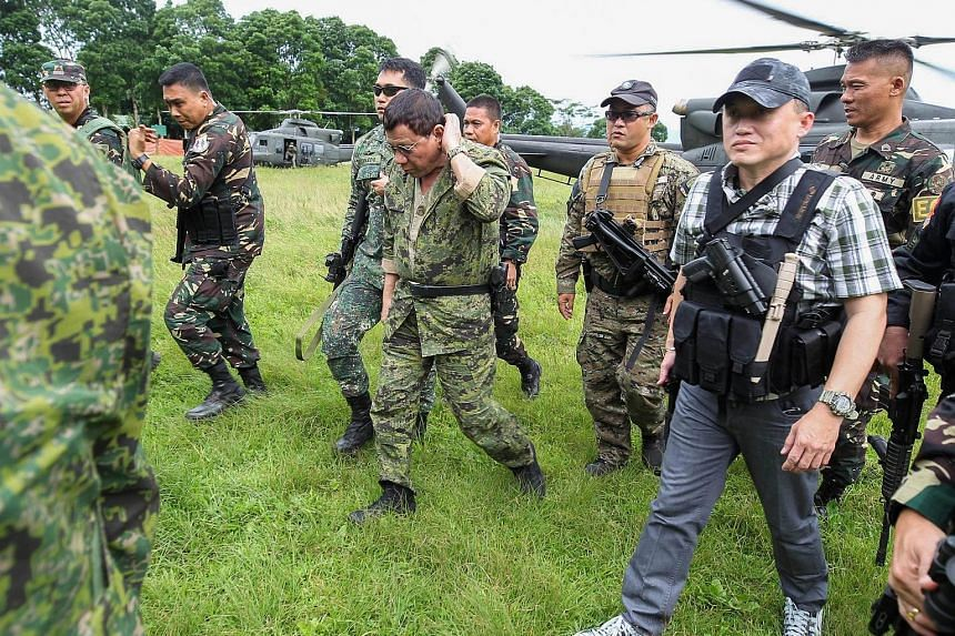 Philippine President Rodrigo Duterte arriving at the military camp in Marawi city, Mindanao, last Thursday. The battle against Islamist militants there is now in its third month.