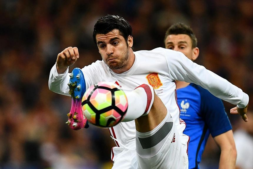 This file photo taken on March 28, 2017 shows Spain's forward Alvaro Morata controls the ball during the friendly football match France vs Spain at the Stade de France stadium in Saint-Denis, north of Paris.
