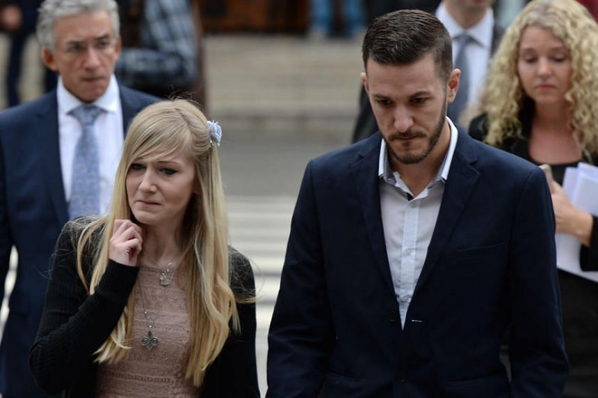 Chris Gard (R) and Connie Yates, the parents of terminally-ill 11-month-old Charlie Gard, arrive at the Royal Courts of Justice in London on July 24, 2017. The parents of the terminally ill baby attend court on July 24 for a further hearing in their