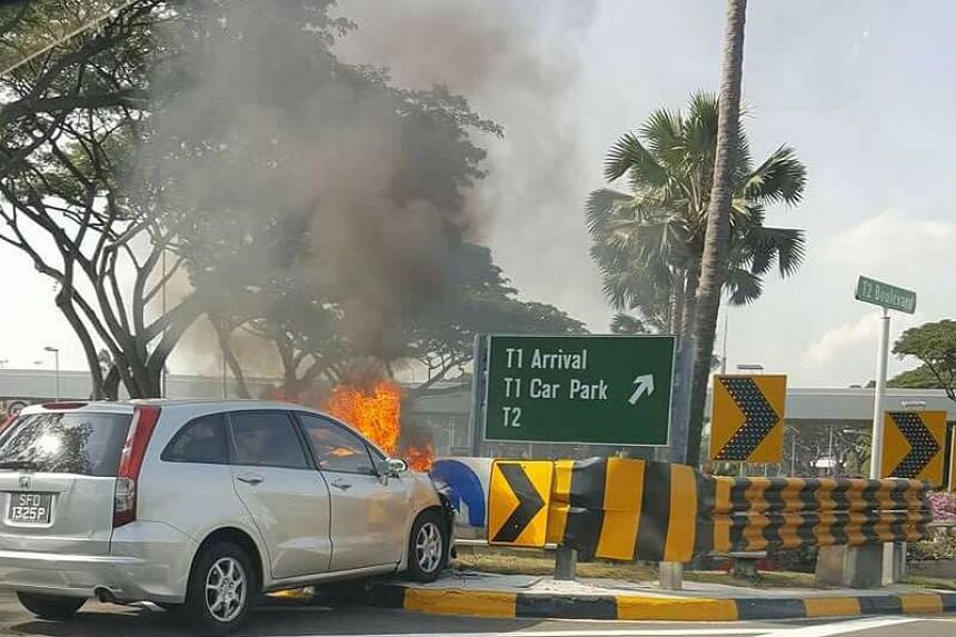 A silver Honda caught fire after it crashed into a road divider near Changi Airport on Monday (July 24).
