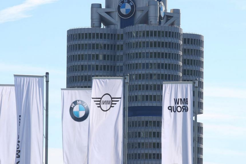 Flags near the headquarters of German luxury carmaker BMW in Munich, Germany. The carmaker has denied colluding with Daimler and Volkswagen to install emissions equipment that was inadequate to do the job.