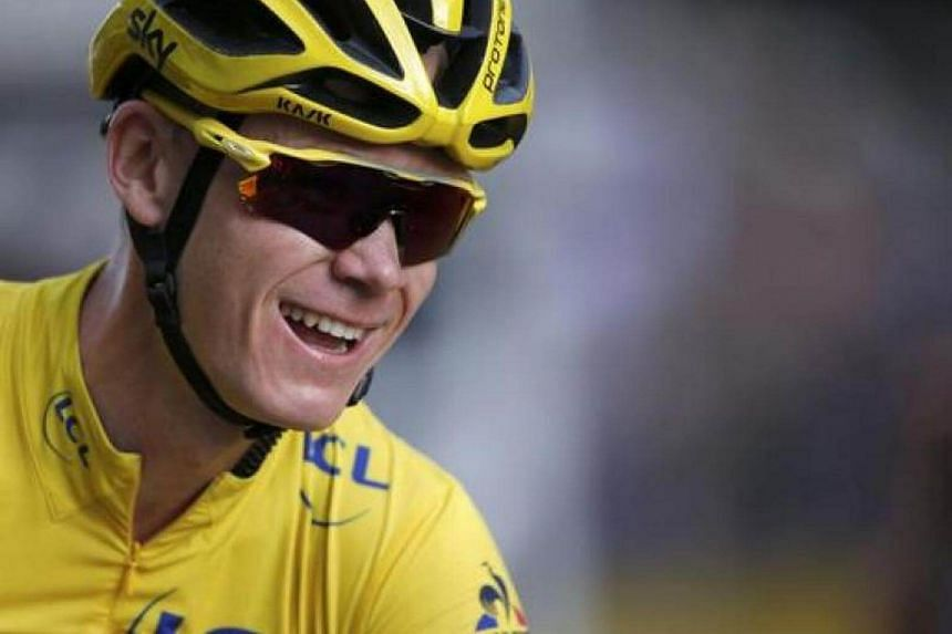 Chris Froome celebrates on the finish line.