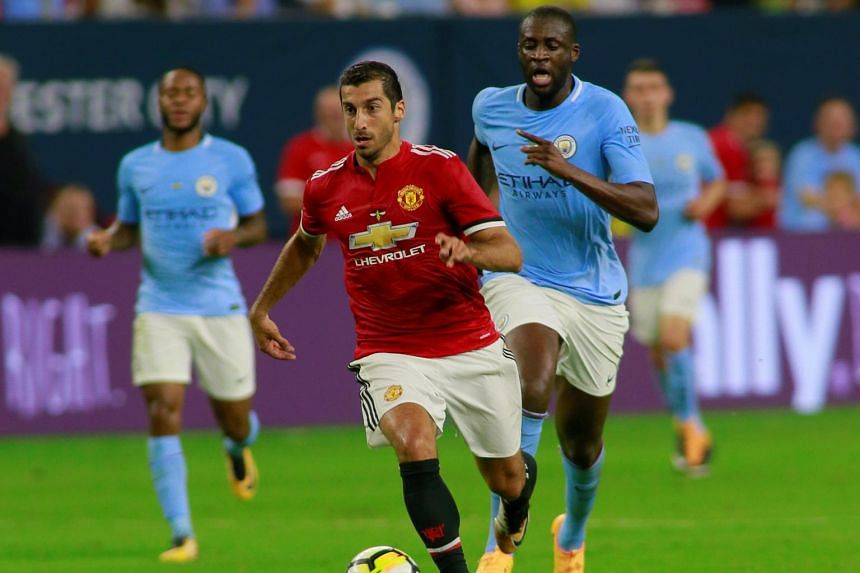 Manchester United's Henrikh Mkhitaryan in action with Manchester City's Yaya Toure in Houston, US on July 20, 2017.