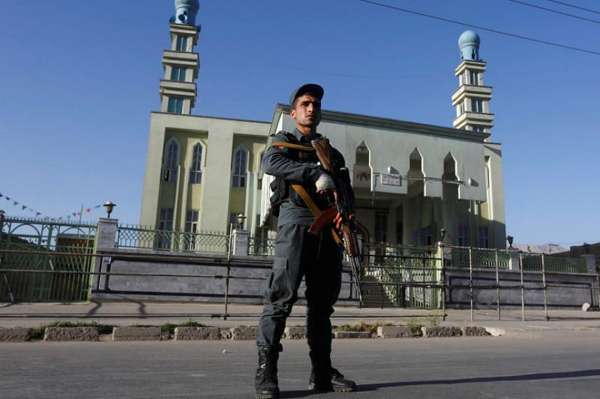 An Afghan policeman stands guard outside a mosque where a suicide bomber detonated a bomb, in Kabul, Afghanistan on June 16, 2017.