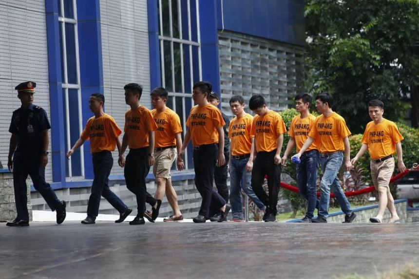The foreign nationals arrested for their alleged involvement in a kidnap-for-ransom crime are taken to Philippine National Police headquarters in Quezon City, east of Manila, Philippines, on July 20 2017. A group of 42 Chinese and two Malaysian natio