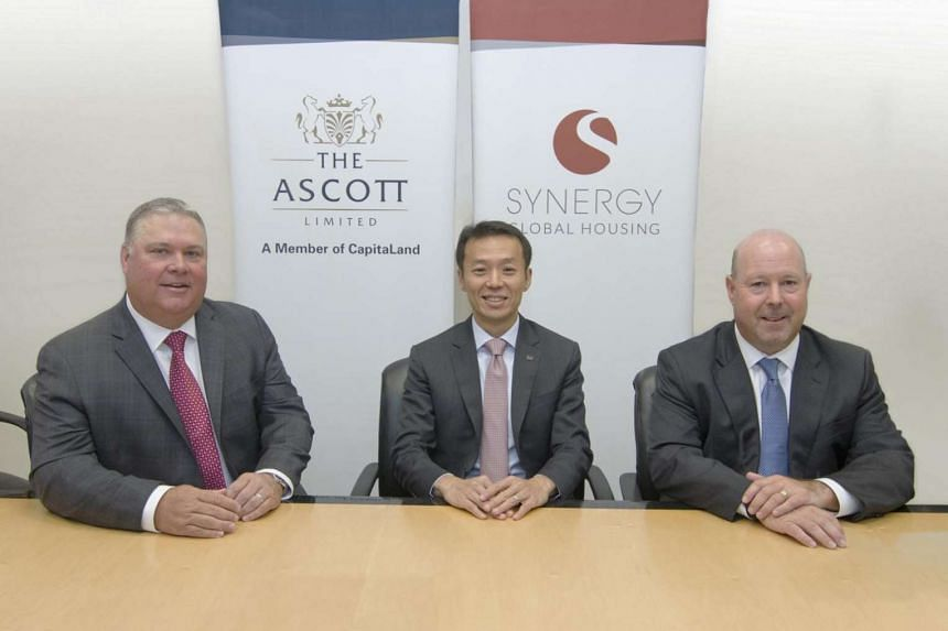 Ascott's CEO Lee Chee Koon with Synergy co-founders Henry Luebbert and Jack Jensky after signing the deal.