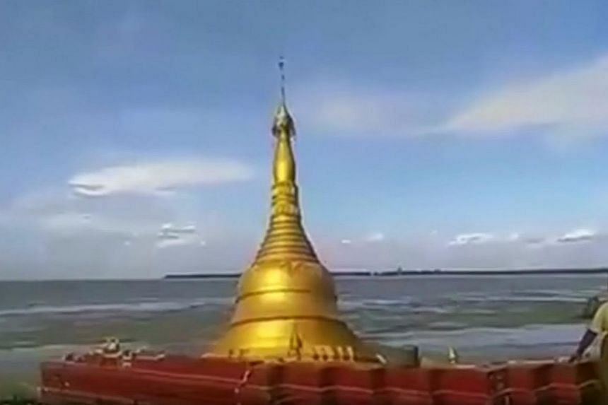 A Buddhist pagoda in central Magway region in Myanmar collapsed and fell into the Ayeyarwaddy River due to rising floodwaters.