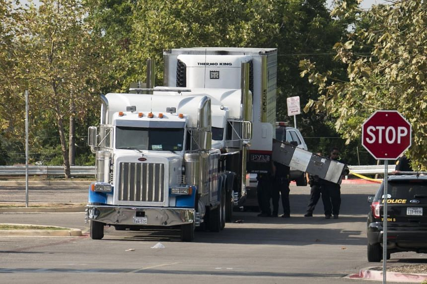 Officials tow a truck that was found to contain 38 suspected illegal immigrants in San Antonio, Texas, US on July 23, 2017.
