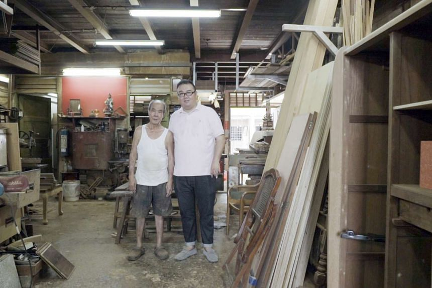 Mr Du (right) and son Kenneth Du (left) are committed to delivering quality workmanship through traditional carpentry. PHOTO: BRAND NEW MEDIA