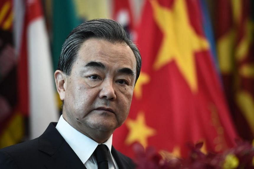 """Chinese Foreign Minister Wang Yi told reporters China would like to """"maintain stability in the South China Sea, abiding by the terms that have been agreed on the Declaration of Conduct and Code of Conduct in near future""""."""