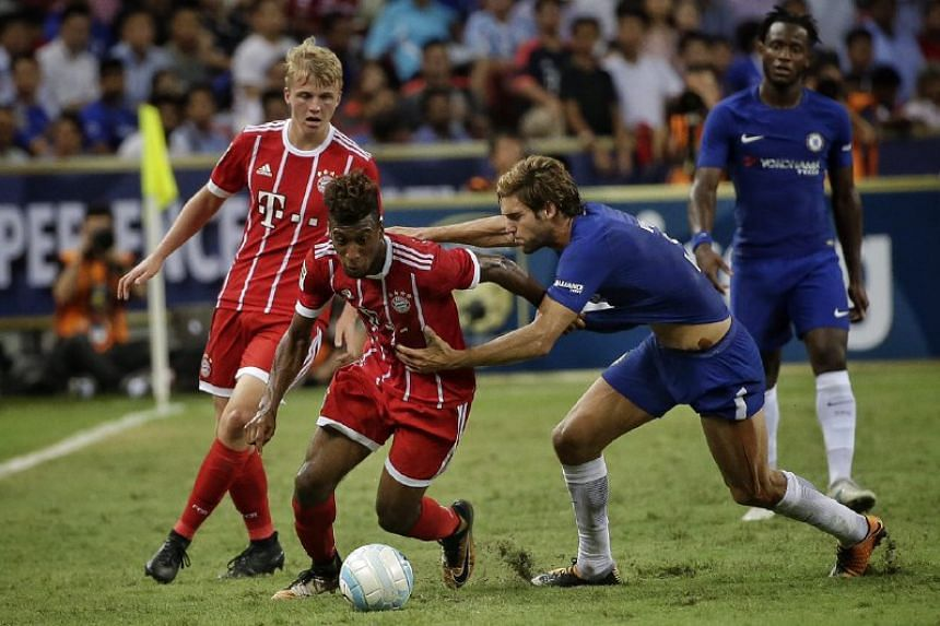 Chelsea's Marcos Alonso (second from right) attempting a rugby tackle on Bayern Munich's Kingsley Coman in the International Champions Cup at the National Stadium on July 25, 2017.