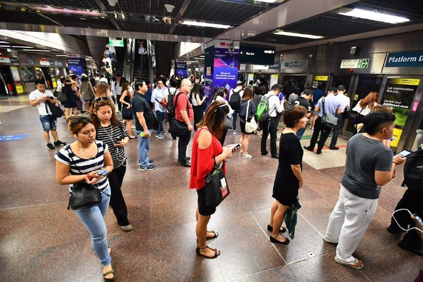 The queue at City Hall MRT station towards Pasir Ris around 8.35am on July 25, 2017.