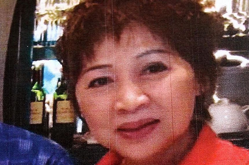 """Ong Choon Lin produced the talismans while his wife Ng Kim Yew (above)  was the """"face'' of the scam, promoting it to her followers."""