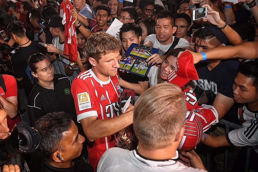 Bayern Munich star Thomas Muller signing autographs for fans at Clifford Square yesterday. The German international had an underwhelming season by his own high standards last term and will want to bounce back ahead of the World Cup.