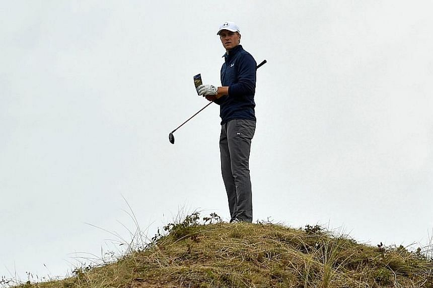American Spieth studying the terrain on where to take the drop after landing in the rough off the 13th tee in the final round. His decision to take the third and final option paid off and he gave up only one shot.