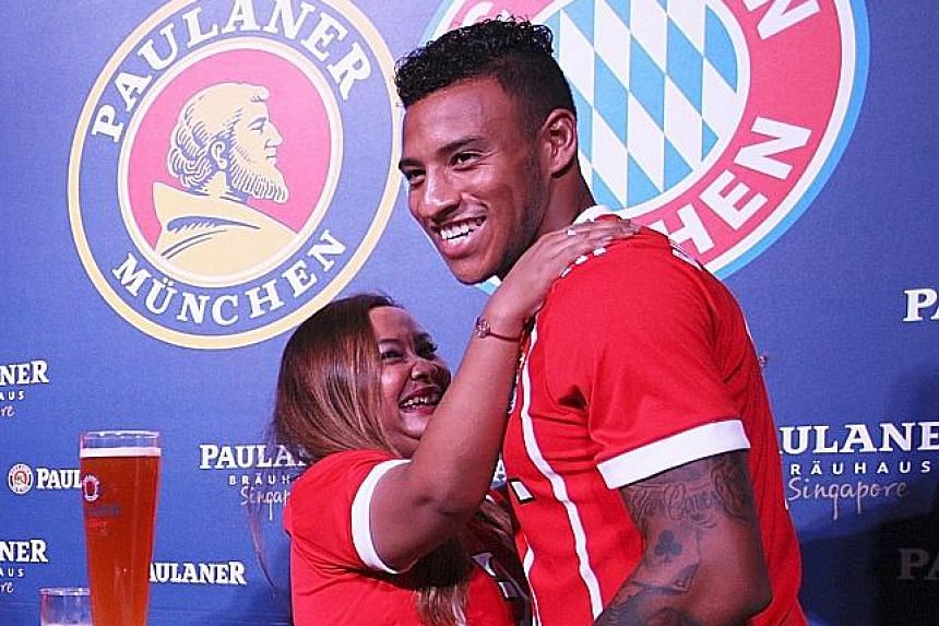 A fan embracing Bayern Munich midfielder Corentin Tolisso during a meet-and-greet session at German restaurant Paulaner Brauhaus. The French international has a tough task ahead to secure a starting berth.