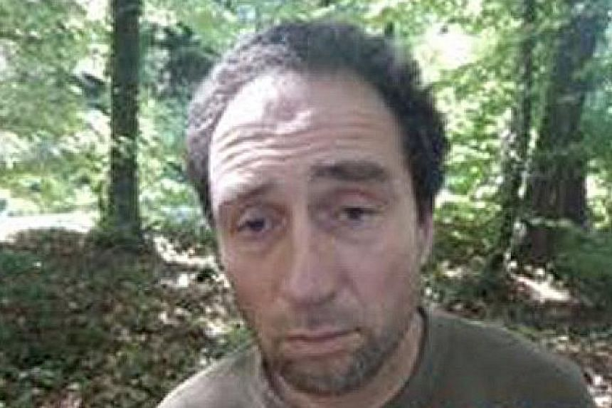 """Forensic officers at the crime site in Schaffhausen yesterday. Police said the assault was """"not an act of terror"""", but also not random. A photograph from the Schaffhausen police website showing Franz Wrousis, the suspect in the chainsaw attack."""