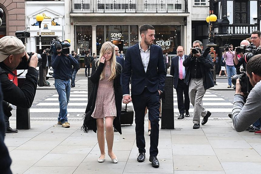 Ms Connie Yates and Mr Chris Gard arriving at the High Court in central London yesterday. The couple had fought a long legal fight to allow them to take their sick child to the US for experimental treatment.