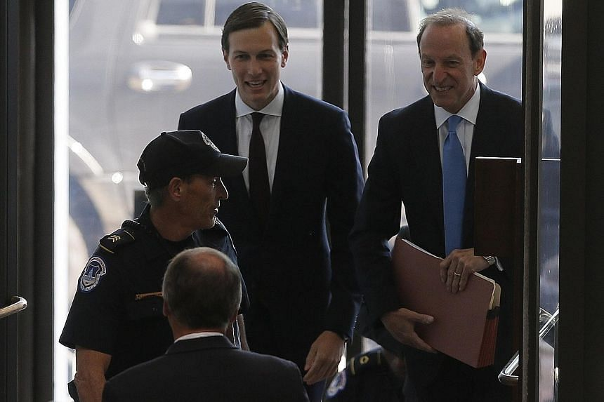 White House senior adviser and Mr Donald Trump's son-in-law Jared Kushner (centre) arriving for his appearance before a closed-door session of the Senate Intelligence Committee on Capitol Hill in Washington yesterday as part of its probe into Russian