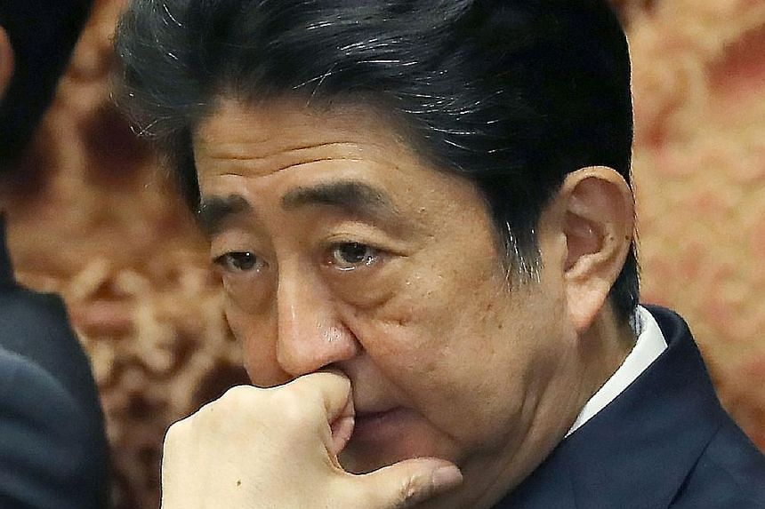 Japanese Prime Minister Shinzo Abe at yesterday's Lower House session. He is fighting allegations that he pulled strings to help educational institution Kake Gakuen, which is run by his close friend Kotaro Kake, win a bid to set up a veterinary schoo