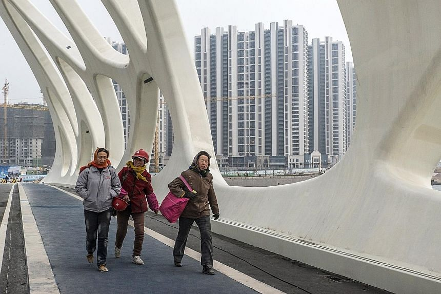 A newly constructed bridge inside Dalian Wanda Group's Oriental Movie Metropolis project site in Qingdao, China. Led by Mr Wang Jianlin, the conglomerate built theme parks and bought hotels under its cultural tourism project.