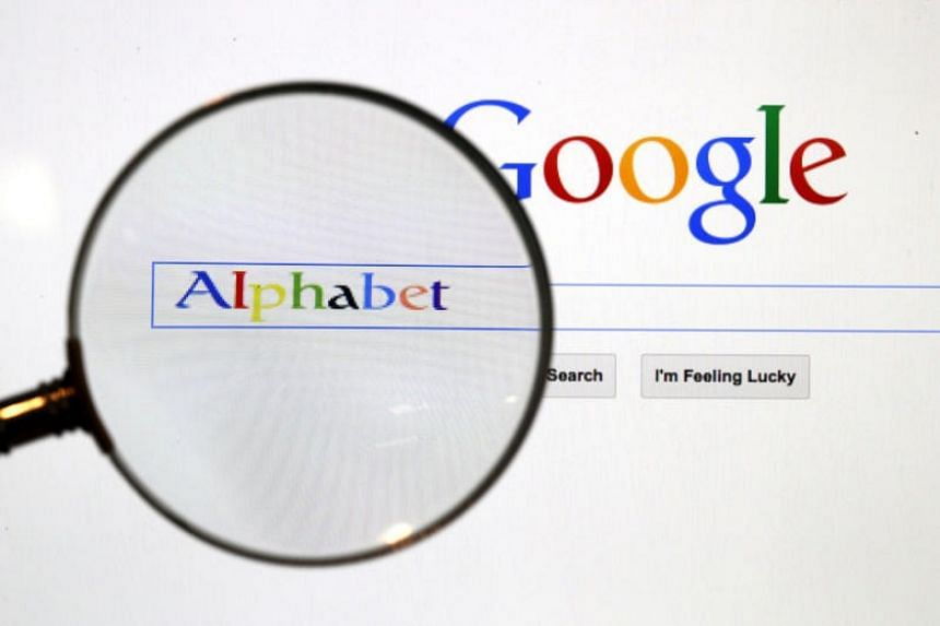 A Google search page is seen through a magnifying glass in this photo illustration taken in Berlin on Aug 11, 2015.