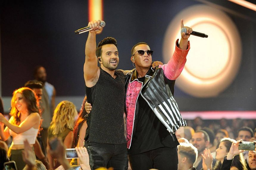 Luis Fonsi and Daddy Yankee performing onstage at the Billboard Latin Music Awards at Watsco Center in Coral Gables, Florida, on April 27, 2017.