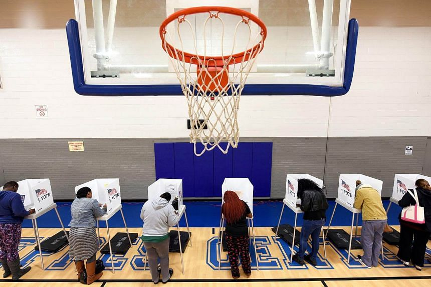 Citizens vote on a basketball court at a recreation center serving as polling place during the US general election in Greenville, on Nov 8, 2016.