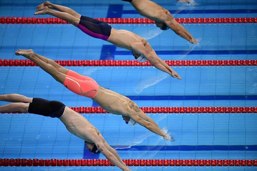 Swimmers competes in the men's 200m freestyle semi-final during the swimming competition at the 2017 FINA World Championships in Budapest, on July 24, 2017.