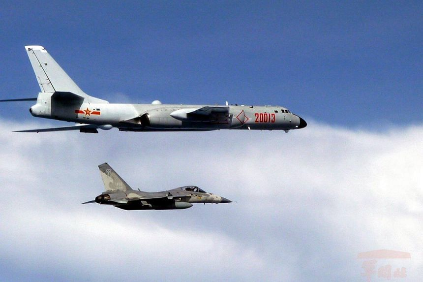 A Taiwan Air Force Indigenous Defense Fighter (IDF) jet (bottom) intercepting a Chinese H-6 bomber after it entered Taiwan's Air Defense Identificaiton Zone (ADIZ) on July 20, 2017.