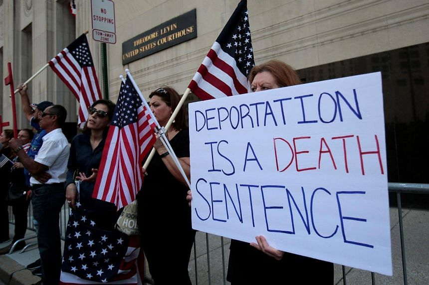 Protesters rally outside the federal court just before a hearing to consider a class-action lawsuit filed on behalf of Iraqi nationals facing deportation, in Detroit, Michigan, US on June 21, 2017.