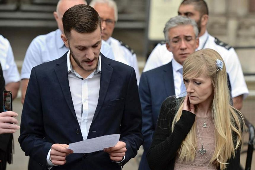 Chris Gard (left) the father of terminally-ill 11-month-old Charlie Gard reads out a statement while Charlie's mother Connie Yates (right) looks on at the Royal Courts of Justice in London on July 24, 2017, after the parents abandoned their legal fig