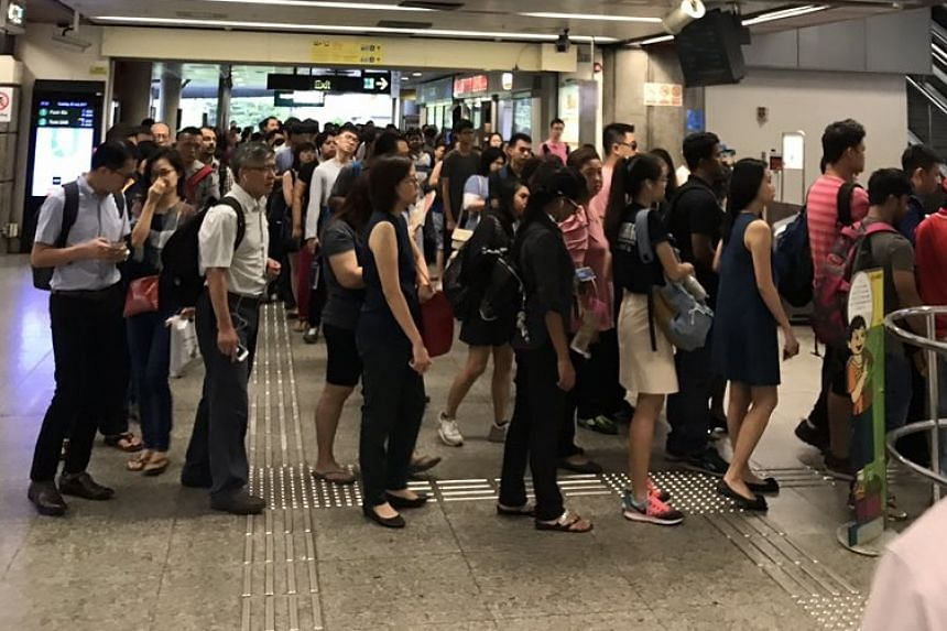 Long queues of commuters waiting to enter Lakeside MRT station on Tuesday (July 25).
