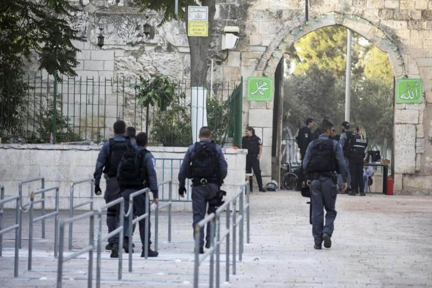 Israeli Border Police walk past the area where metal detectors were removed at an entrance to the al-Aqsa Mosque compound in Jerusalem's Old City, on July 25, 2017.