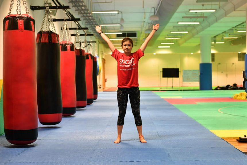 ActiveSG trainer Samantha Low, 25, demonstrating a starfish squat and reach.